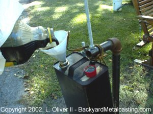 A homemade waste oil burner Burning used motor oil for heat